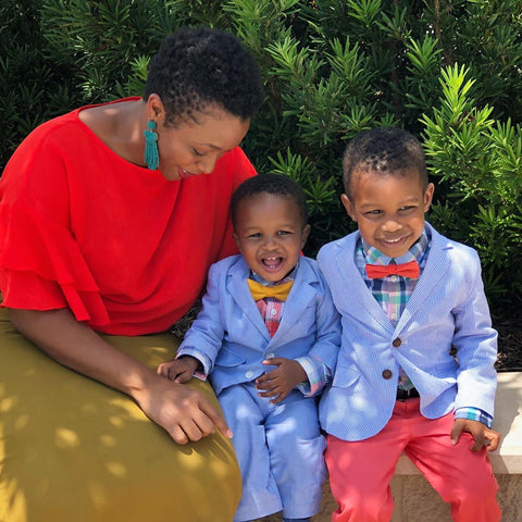 black mom with boys in bow ties and suits