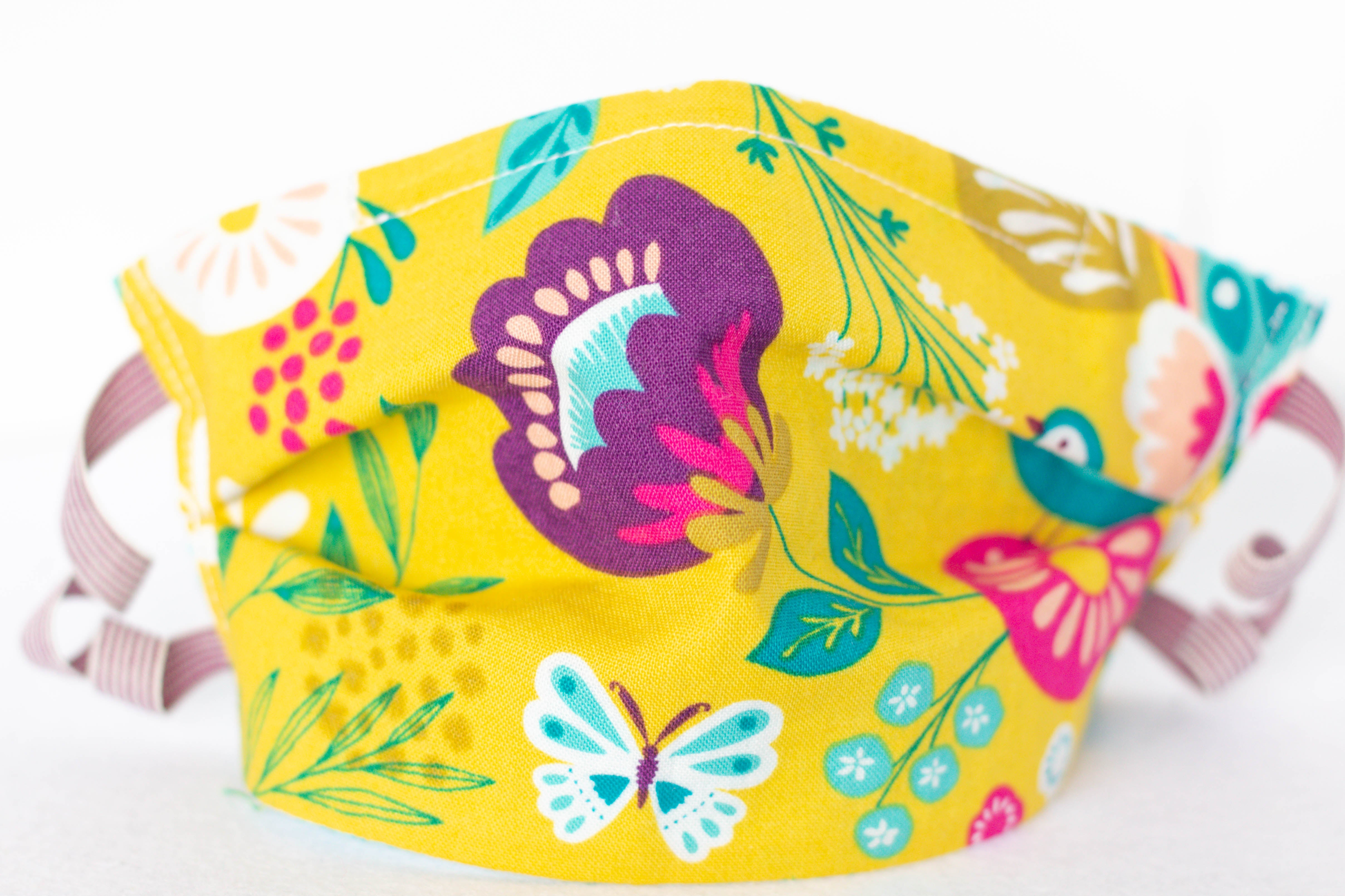 kids face mask yellow, purple, teal, flowers with butterflies and birds
