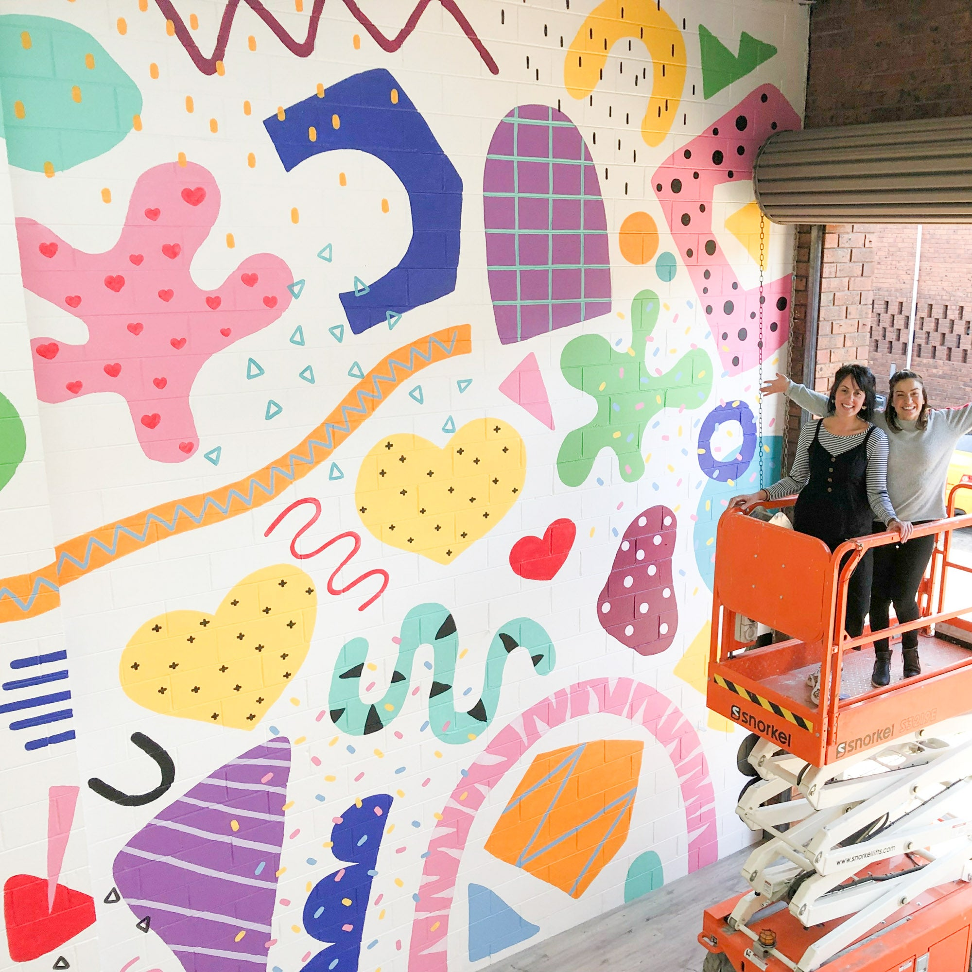 Deb McNaughton Artist - finished work- Massive wall mural - painting on forklift - Big wall - Sweetsticks -  Melbourne