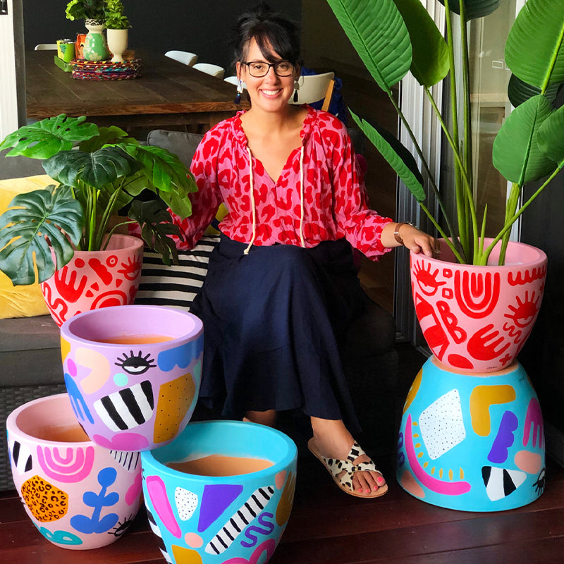 Deb McNaughton artist - Deb McNaughton with her hand painted terracotta pots-Aspendale