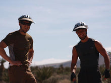 Load image into Gallery viewer, Two mountain bikers wearing the Da Brim Rezzo helmet visor.
