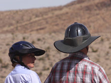 Load image into Gallery viewer, Two Trail riders. Female is wearing the Da Brim Rezzo helmet visor and male is wearing the Da Brim Equestrian Endurance helmet brim visor in gray.
