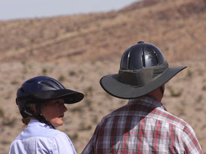 Two Trail riders. Female is wearing the Da Brim Rezzo helmet visor and male is wearing the Da Brim Equestrian Endurance helmet brim visor in gray.