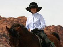 Load image into Gallery viewer, Female rider on a horse. Rider is wearing the Da Brim Equestrian Petite Helmet Brim Visor in black.