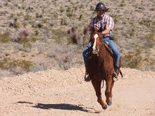Load image into Gallery viewer, Male rider in western style wearing the Da Brim Equestrian Petite Helmet Brim Visor in chocolate brown while galloping on a horse.