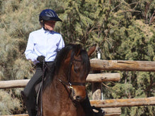 Load image into Gallery viewer, Woman practicing Dressage in an outdoor ring. She is wearing the Da Brim Rezzo helmet visor