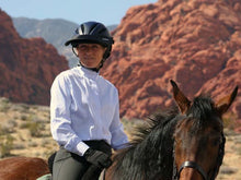 Load image into Gallery viewer, Woman trail riding against a backdrop of red rocks. She is wearing the Da Brim Rezzo helmet visor in black.