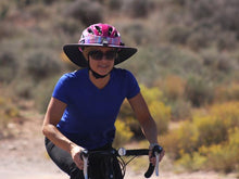 Load image into Gallery viewer, Female road cyclist wearing the Da Brim Sporty Cycling Helmet Visor Brim in pastel ribbons
