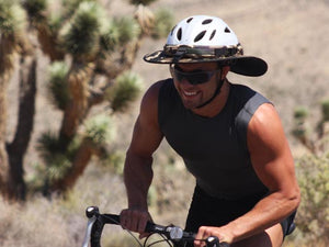 Male road cyclist pictured riding in the desert with a Da Brim Sporty Cycling Helmet Visor Brim.