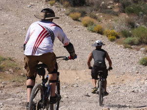 Two mountain bikers riding downhill while wearing the Da Brim Sporty Cycling Helmet Visor Brim