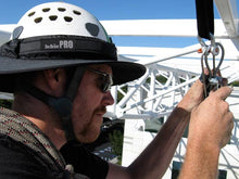 Load image into Gallery viewer, Rigger wearing the Da Brim PRO Tech Construction Helmet Visor Brim in gray while on the jobsite.