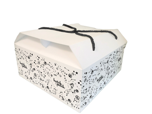 black and white gift box with black cord