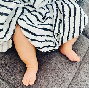 Stripes design swaddle in black and white with feet