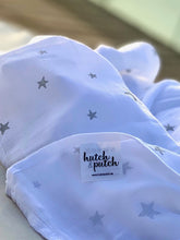 Load image into Gallery viewer, white swaddle with silver star made of organic bamboo and cotton