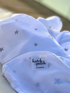 white swaddle with silver star made of organic bamboo and cotton