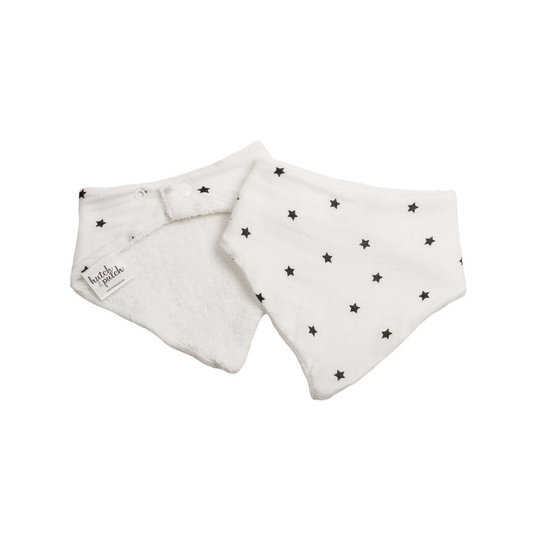Baby bib with several black stars on front side. Backside terry toweling in white