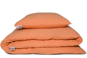 Muslin bed linen in apricot color