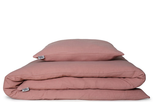 light pink bed linen including muslin pillow case and quilt cover