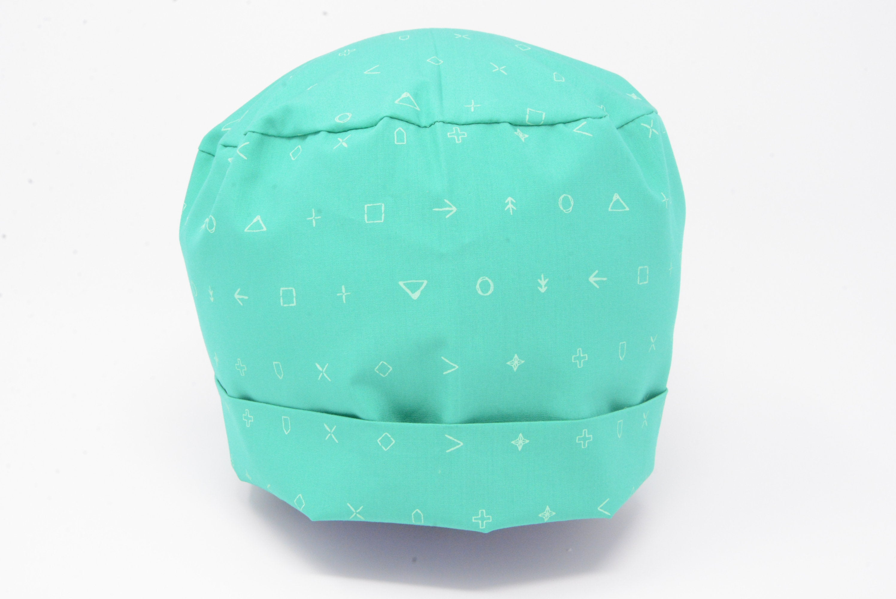 Geometric Patterns on Teal