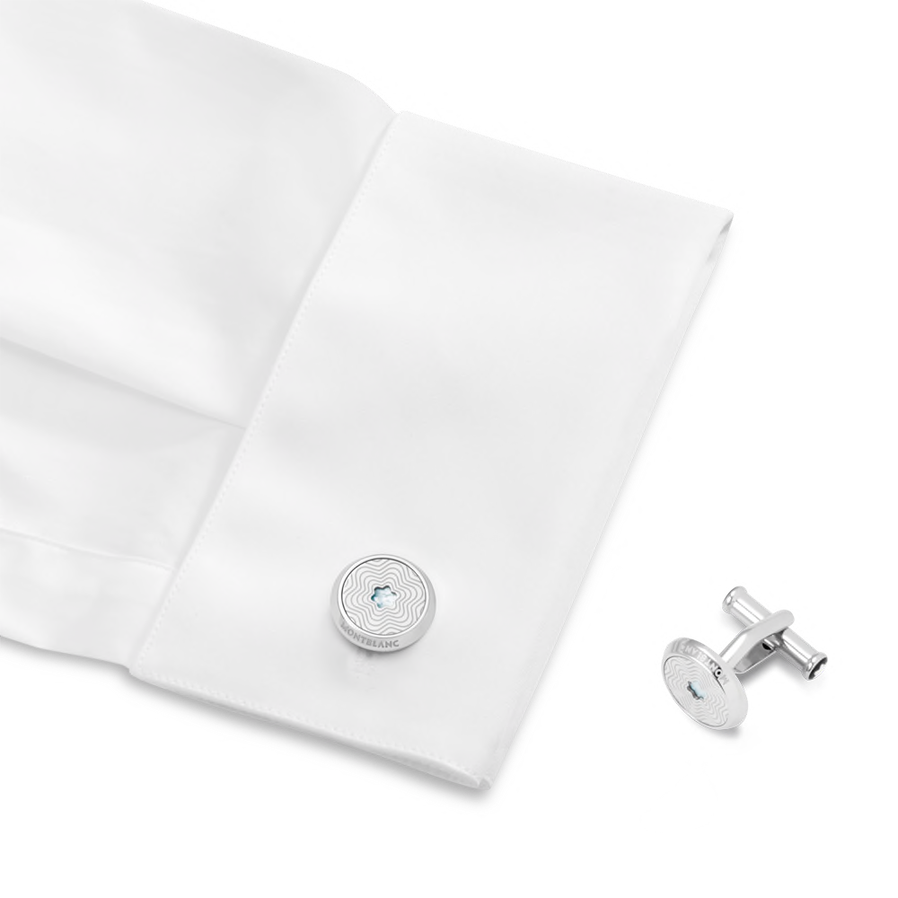Cufflinks, round in stainless steel with exploding star pattern and mother-of-pearl snowcap emblem