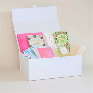 Amala Curation's White Good Vibes Deluxe Gift Box, with several products inside.