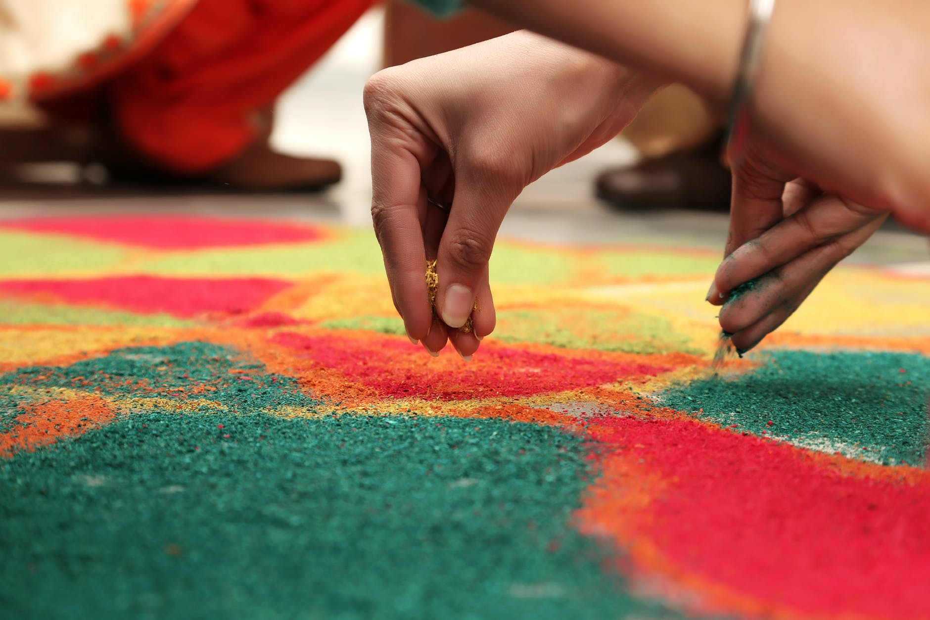 Women's hand making rangoli pattern