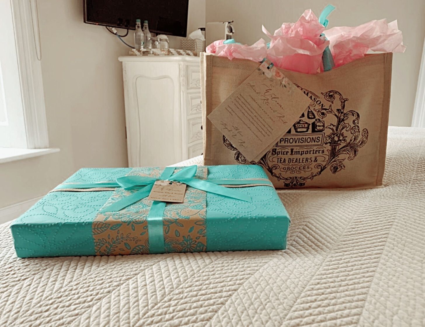 present and gift hamper on bed