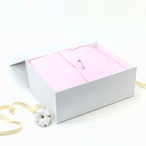 Amala Curations White Luxury Gift Box, lined with pink fabric, closed with a nappy pin