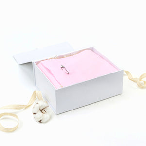 Amala Curations Luxury Ethical Gift Box/ Hamper; white box lined with pink fabric, closed with a nappy pin; with cotton ribbon underneath.