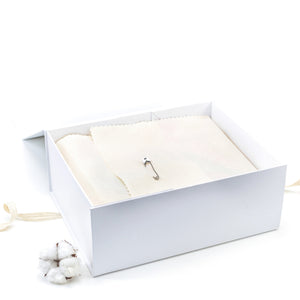 Amala Curations White Luxury Gift Box, lined with cream fabric, closed with a nappy pin