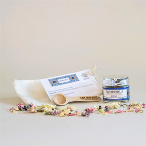 Casa Mencarelli Green Clay and Lemon Face Mask & Scrub, in small glass jar, with mini wooden spoon and organic cotton bag.