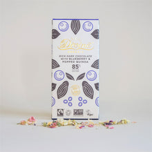 Load image into Gallery viewer, Divine Organic Dark Chocolate 85% Cocoa with Blueberry and Popped Quinoa, in White and Blue Packaging. Vegan.