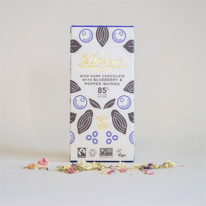 Divine Organic Dark Chocolate 85% Cocoa with Blueberry and Popped Quinoa, in White and Blue Packaging. Vegan.