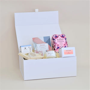 Amala Curation's Restore Deluxe White Gift Box with Odylique Calendula Balm, Verdant Alchemy Natural Mineral Ascent Bath Salts, Wildheart Organic's Restore Travel Candle, Pukka Elderberry and Echinacea Organic Tea 20 Tea Bags, Clear Quartz Crystal