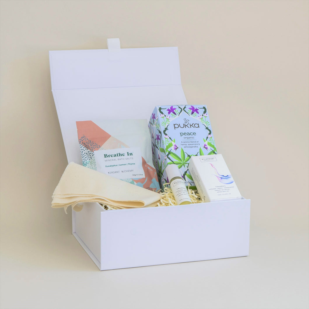 Amala Curation's Serenity Gift Box with Wildheart Organic's Tranquil Aromatherapy roll on, Verdant Alchemy's Breathe In Bath Salts, Pukka Peace Organic Tea