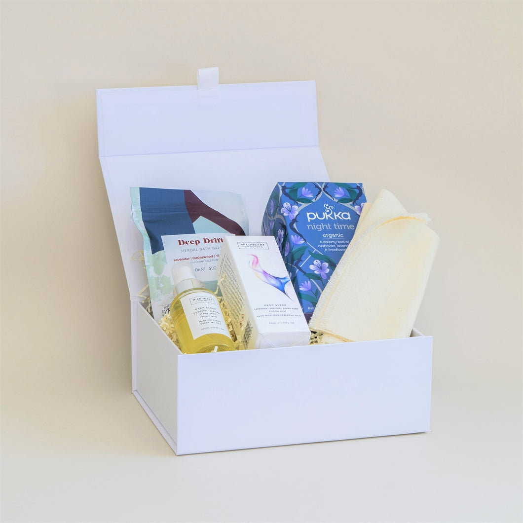 Amala Curation's Sleep Well Gift Box with Wildheart Organic Deep Sleep Pillow Spray, Verdant Alchemy Deep Drift Mineral Bath Salts, Pukka Night Time Organic Tea.
