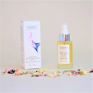 Wildheart Organic Deep Sleep Pillow Mist, Glass Bottle with white cardboard box, with pink and blue graphic.