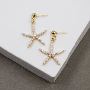 Skinny starfish earrings with multiple pearls inset