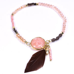 Delicate beaded bracelet with feather