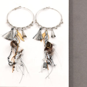 Hoop earrings with muted coloured beads and feathers