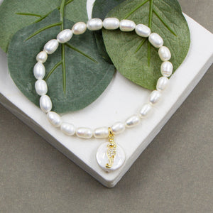 Real pearl stretchy bracelet with button pearl charm with seahorse