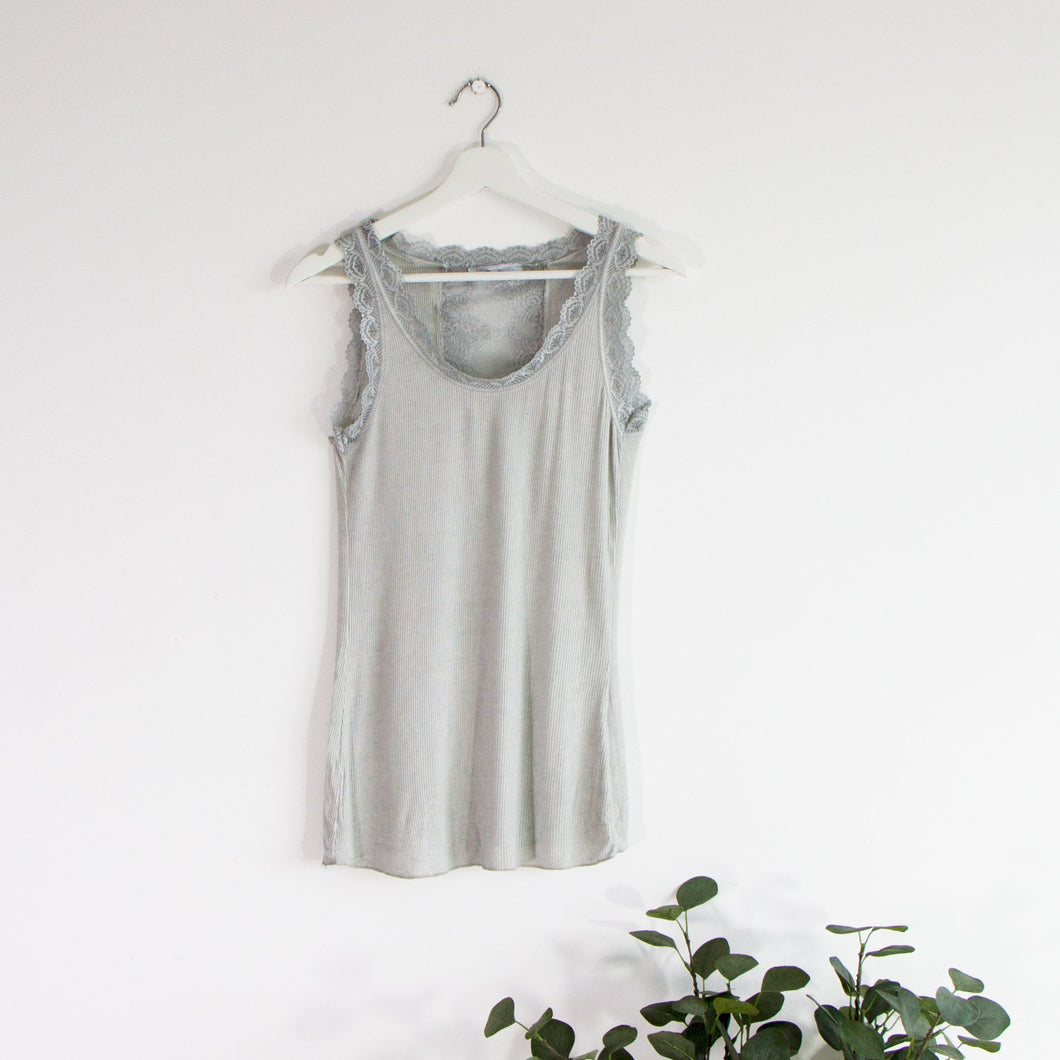 Ribbed vest top with lace hem and neckline and a lace panel