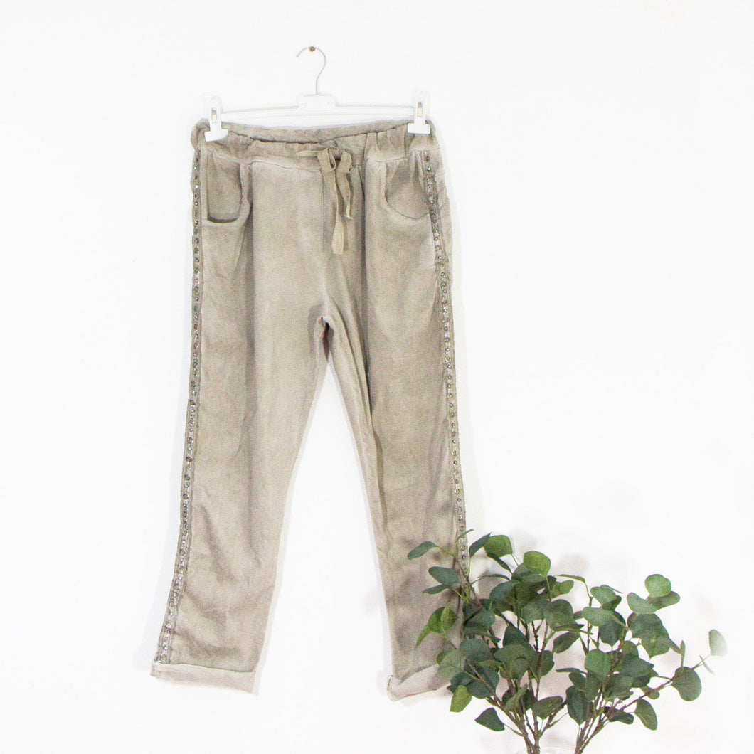 Stretchy vintage wash trousers with drawstring waist pockets and eyelet crystal silver trim