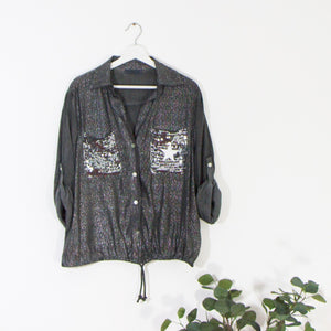 Special silver fabric shirt with sequin pocket and star motif