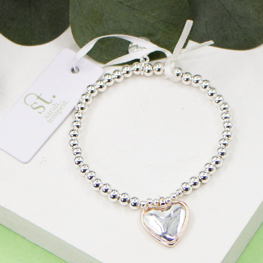 Heart charm on stretchy beaded bracelet