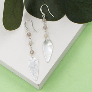 Elongated oval shape charm and beads on fish hook earrings