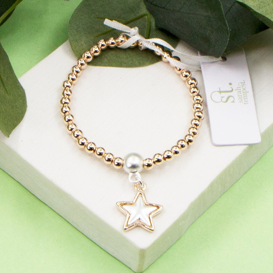 Stretchy beaded bracelet with rose gold star charm and matte silver inlay