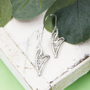Elongated open heart shapes with crystals on fish hook earrings