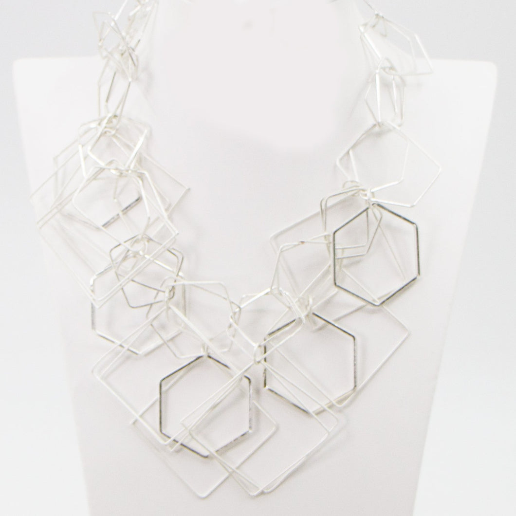 Open geometric shapes statement necklace