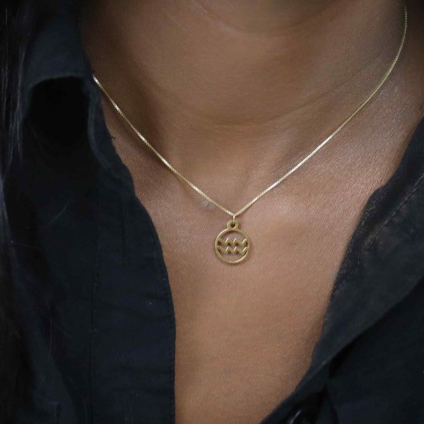 Model Wearing Charming Zodiac Aquarius Minimalist Solid Gold Pendant By Jewelry Lane